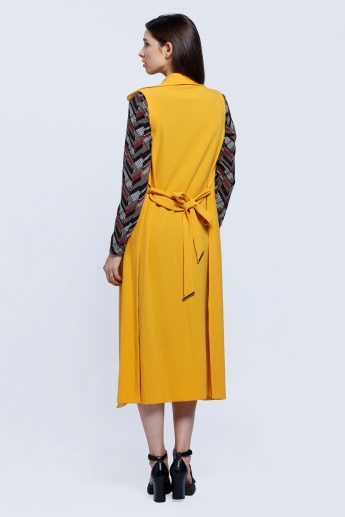Long Sleeveless Jacket with Slide Slits and Tie Up Back